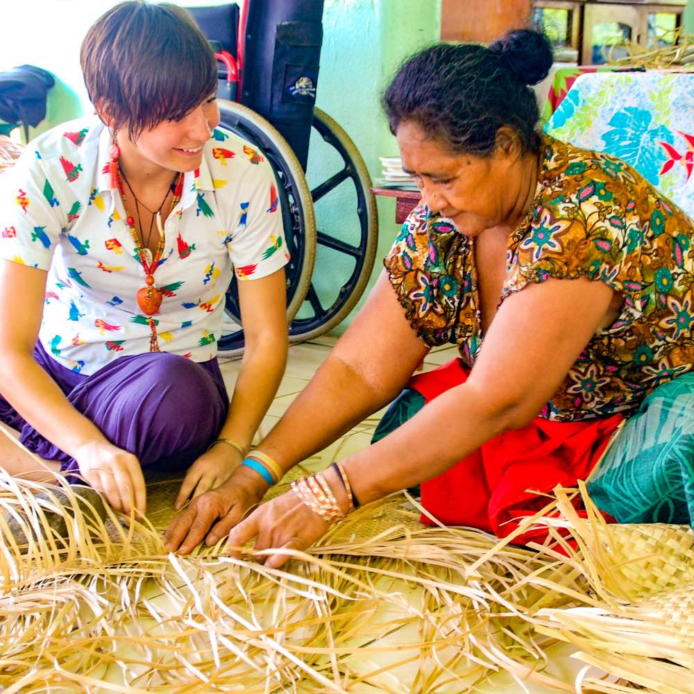 SIT student weaving traditional baskets with Samoan woman