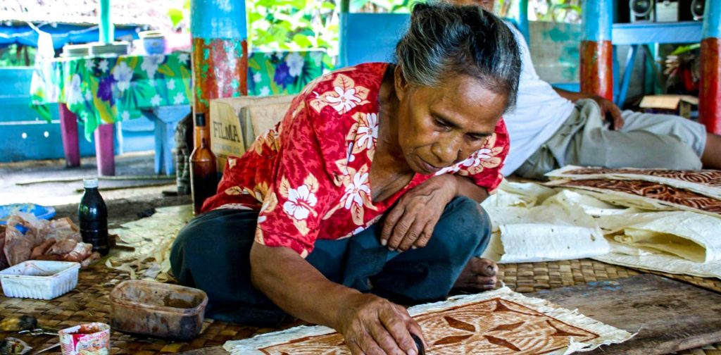 Samoan woman making tapa cloth
